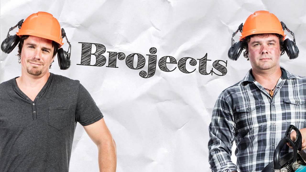 Two men in hard hats with the word 'Brojects' in pencil between them