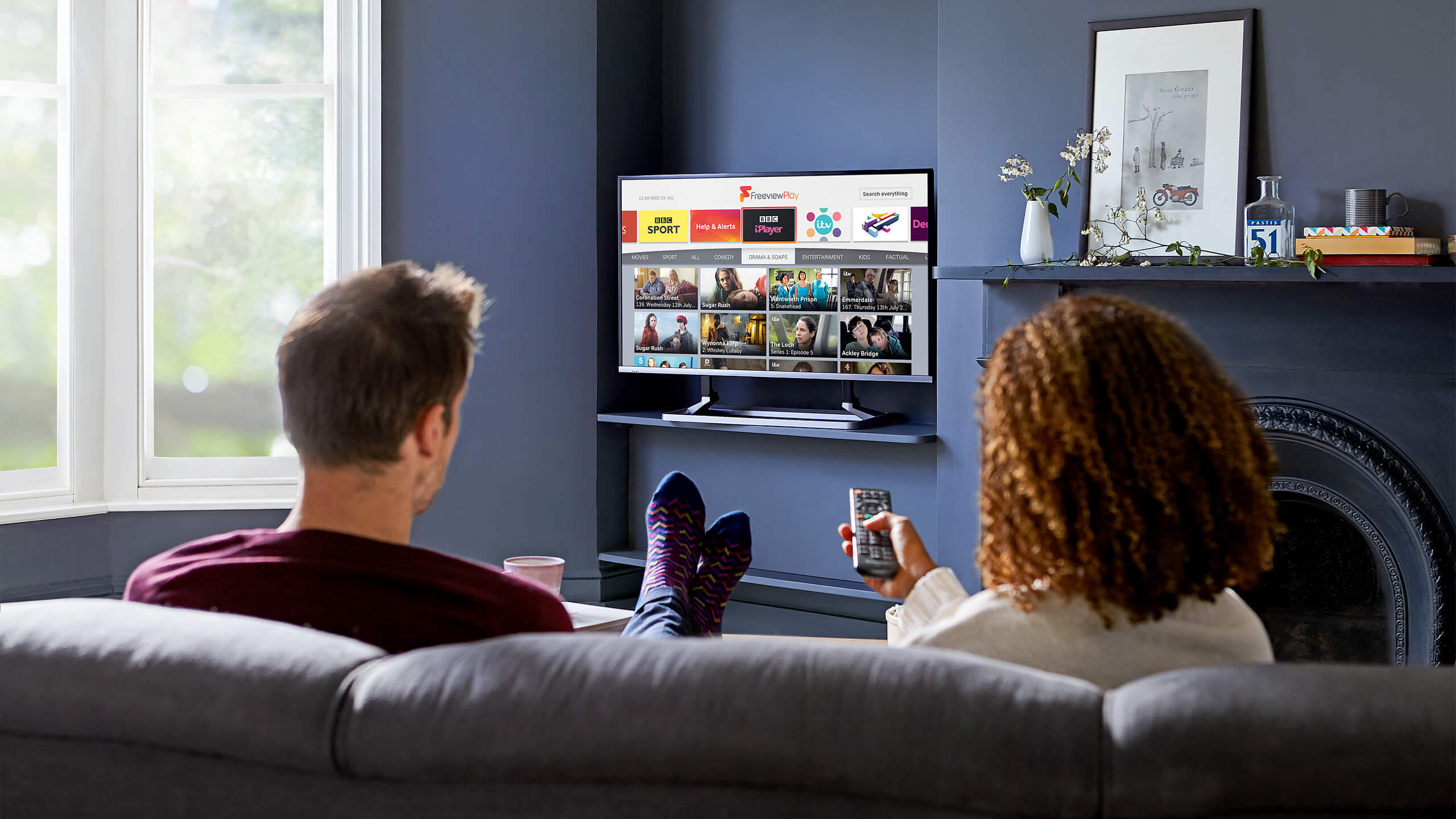 two people watching Freeview Play