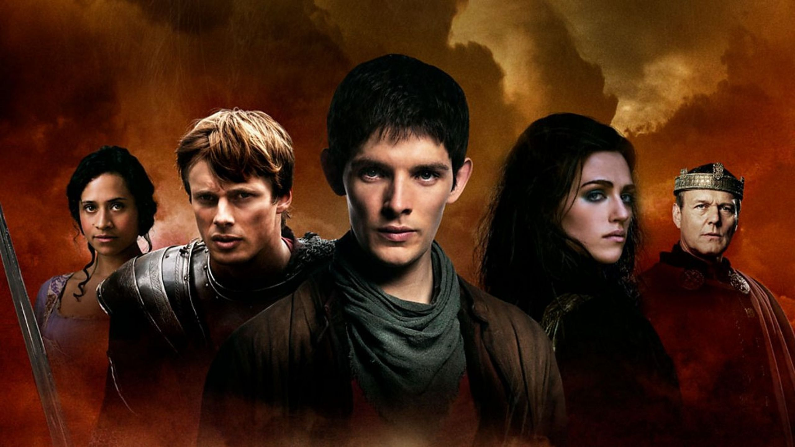 Promo image of the Merlin cast, all wearing traditional Medieval style clothing