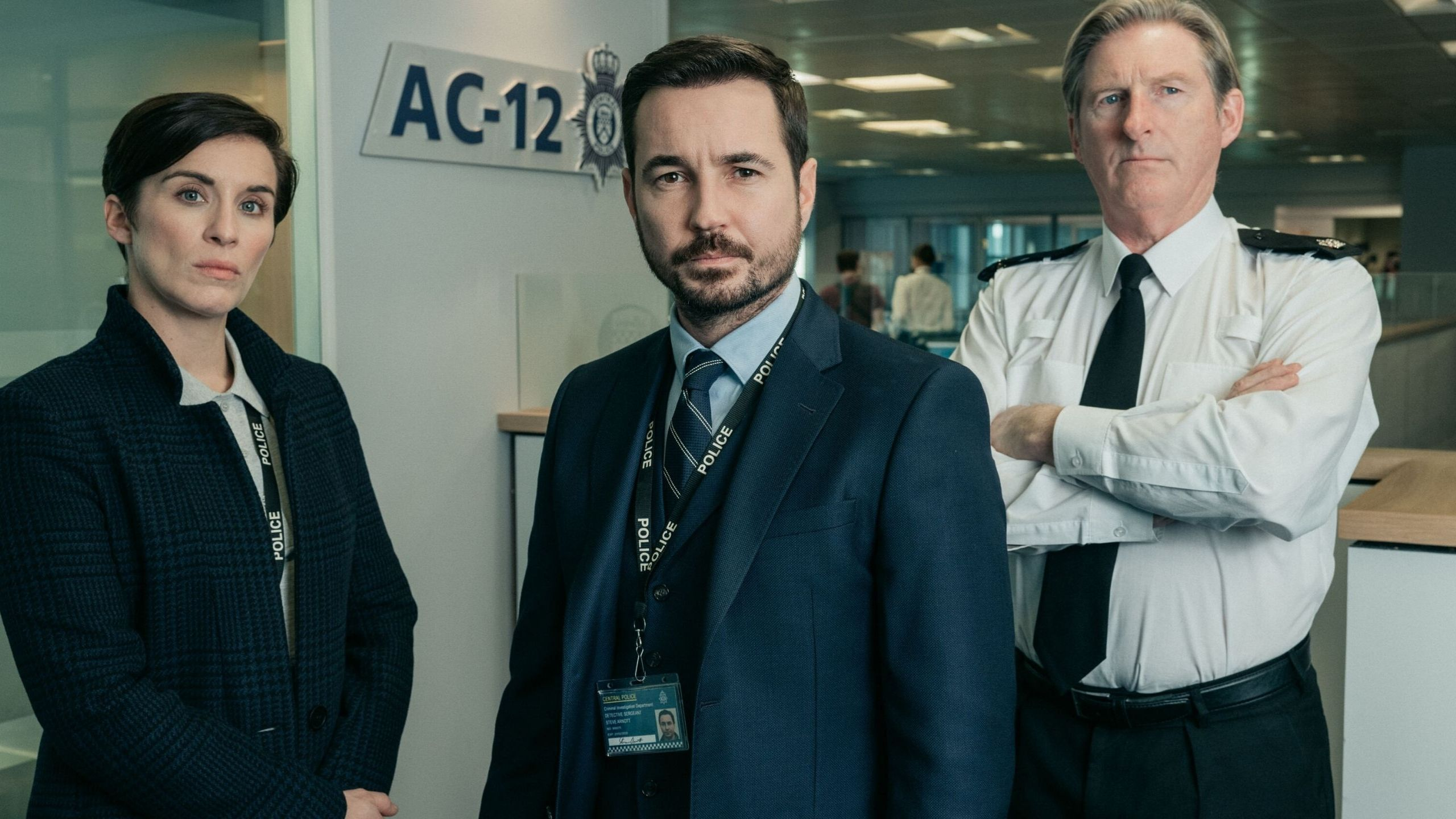 Cast of Line of Duty stood in a police department looking
