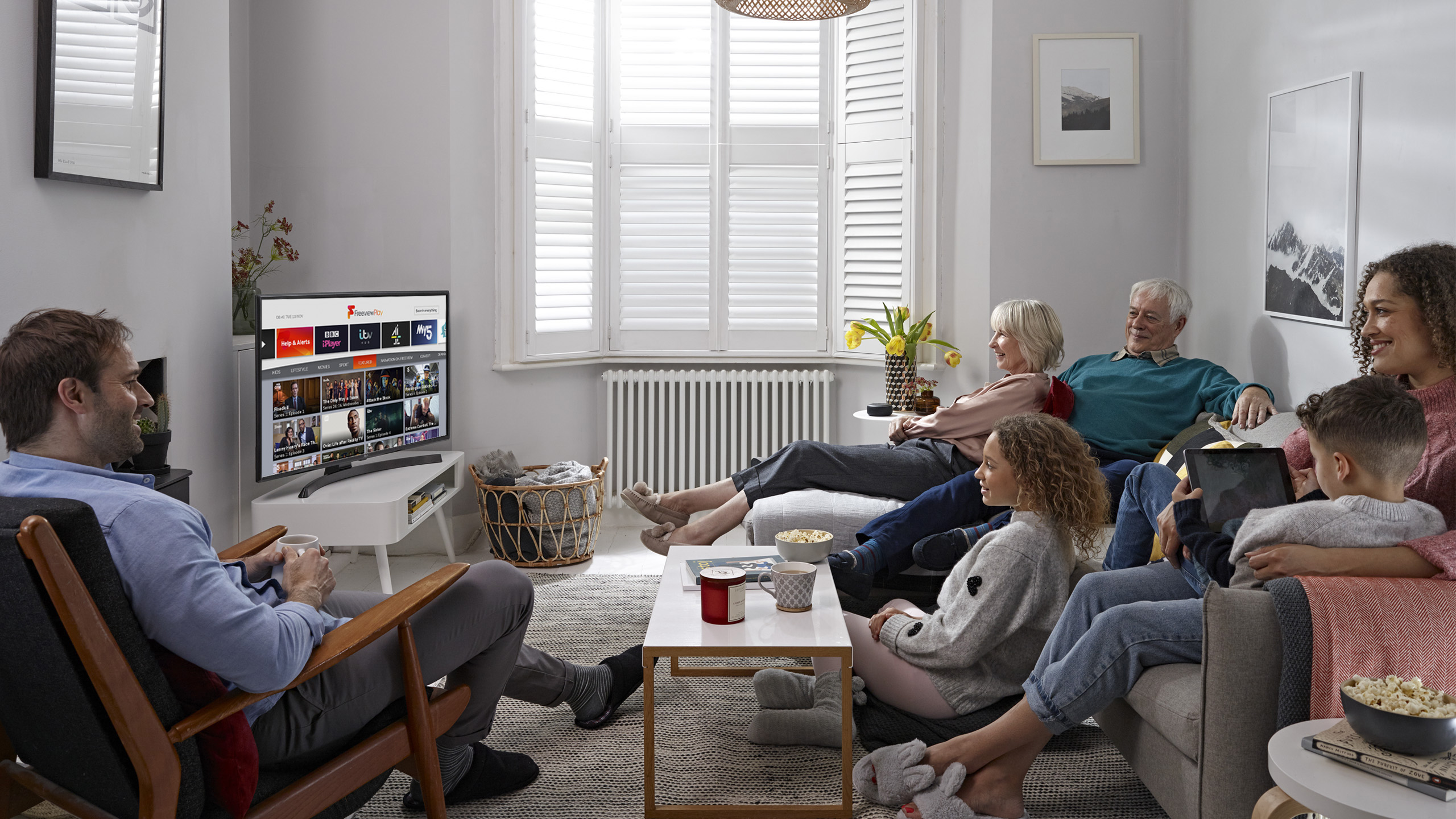 Family group watching Freeview Play
