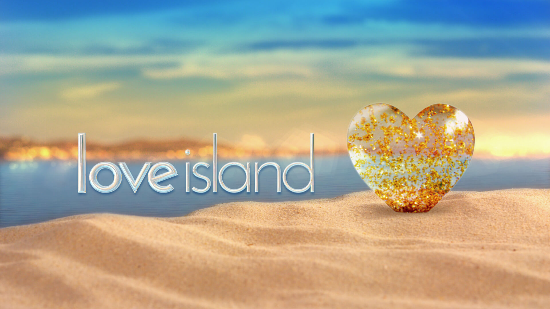 Love Island screen with sea, sand and glittering heart