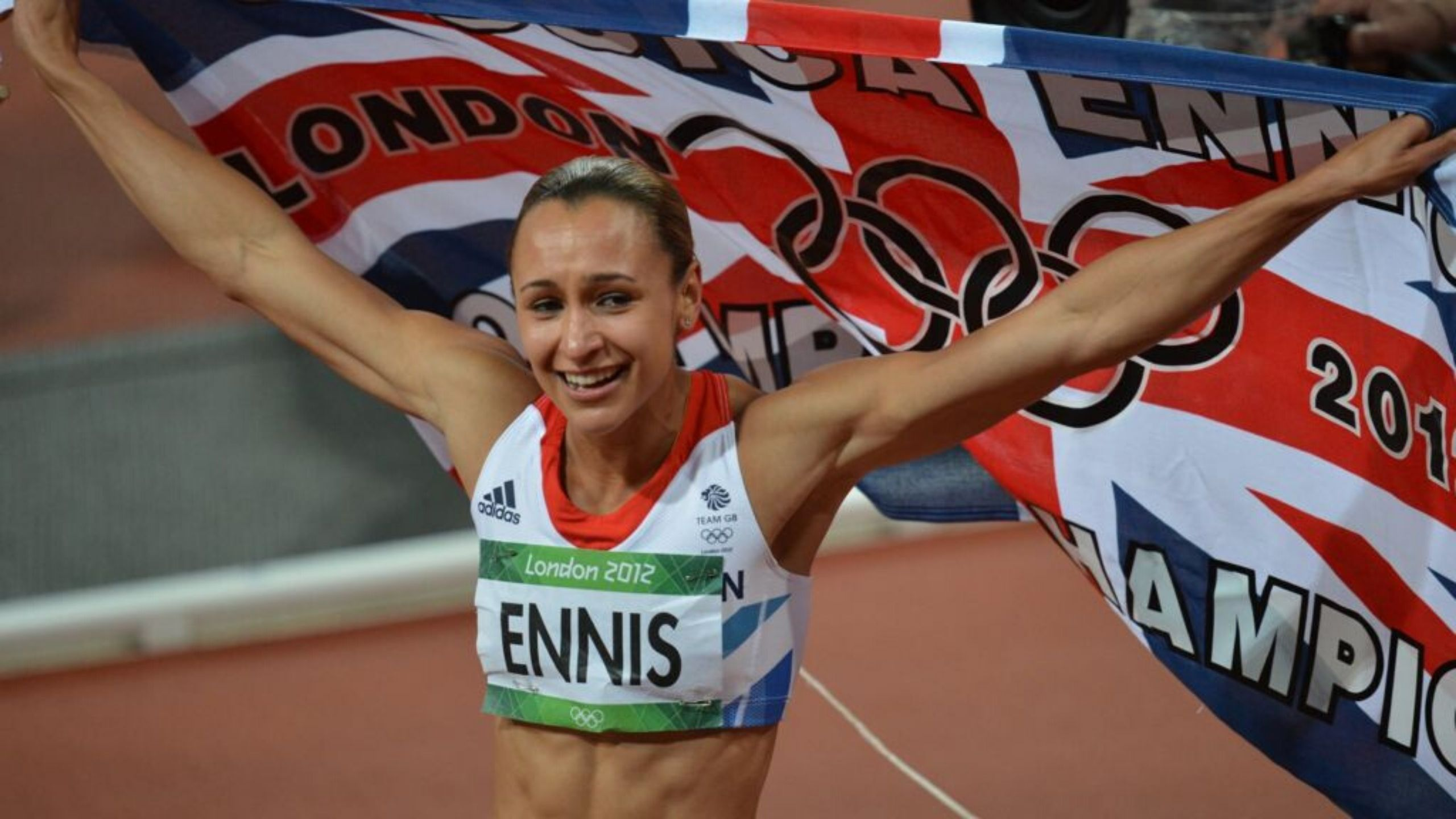 Jessica Ennis-Hill competing in the 2012 Olympics whilst carrying a Union Jack flag