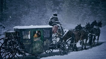 Horse drawn carriage battling through the snow, a scene from Dracula 2019