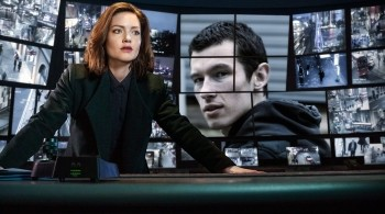 Image of Detective Carey from BBC's The Capture, standing behind CCTV screens