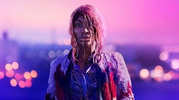 Michaela Cole in I May Destroy You, stood with wet hair against the London skyline at dawn