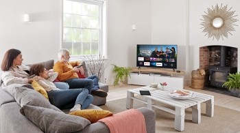 Family choosing what to watch on a Freeview Play Amazon Fire TV Edition