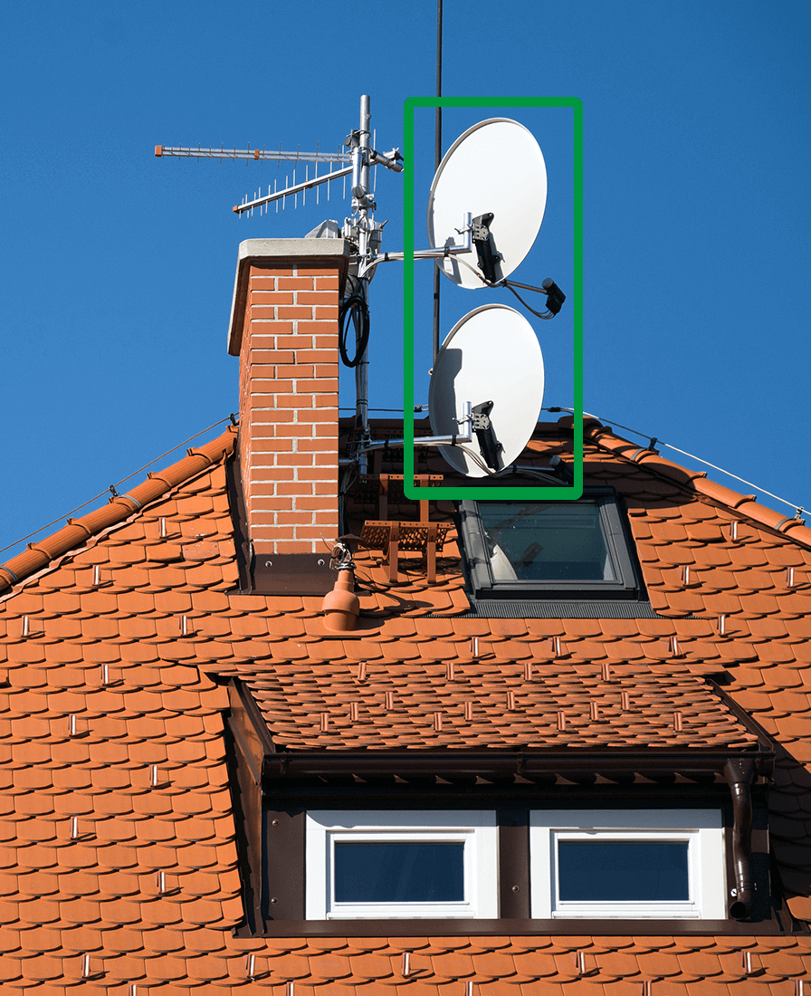 Satellite dishes on the roof of a house